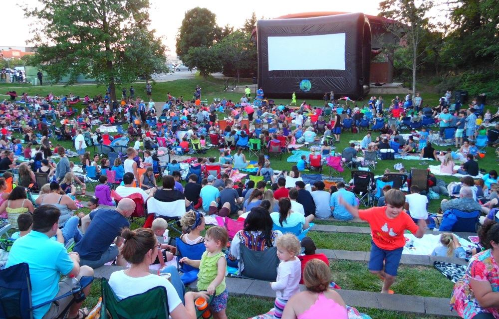 Patrons gather for After Dark Movies in the Park.