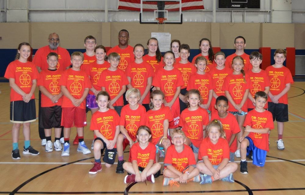Children gather during basketball camp.