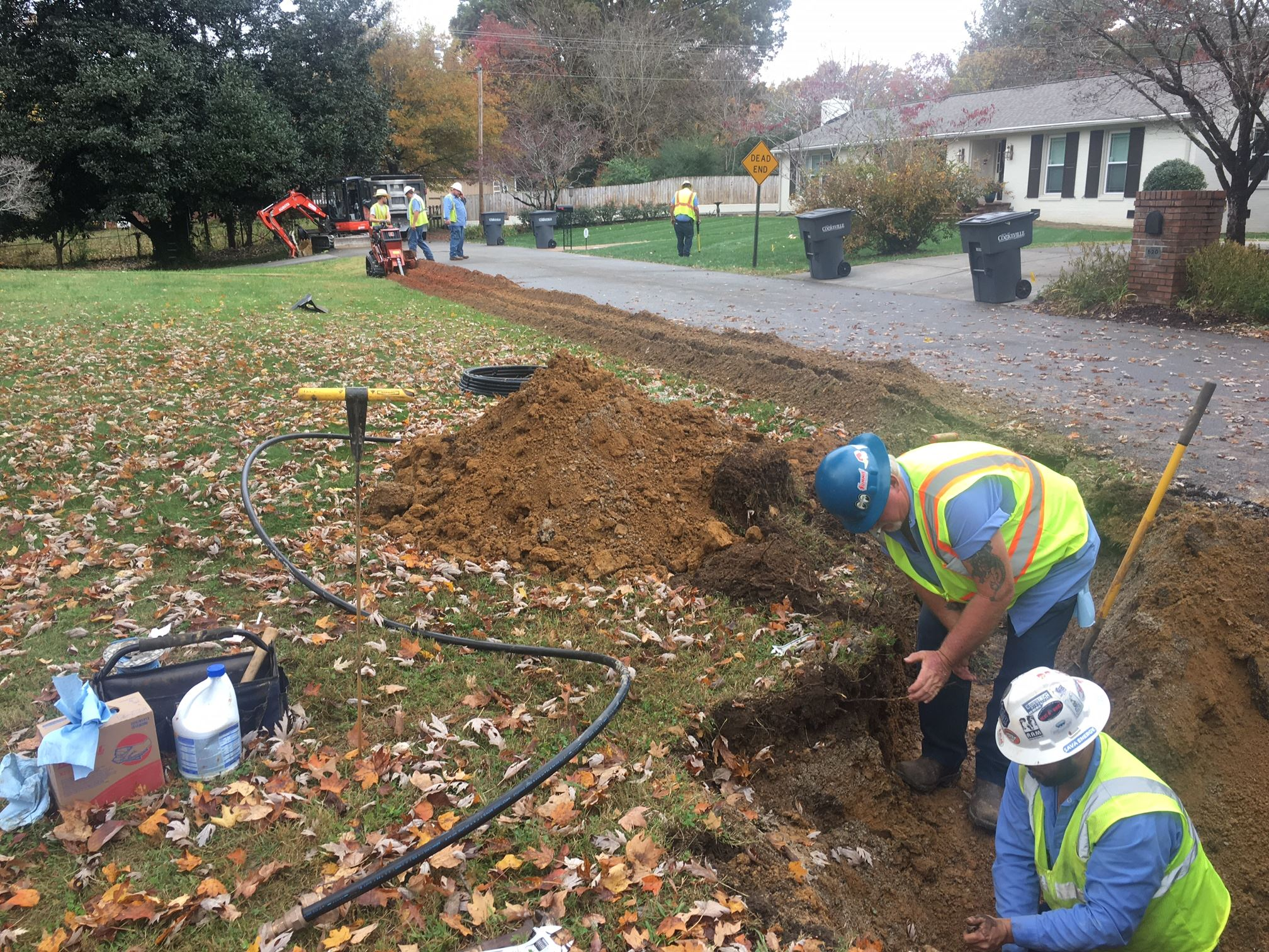 Crews Laying Service Line and Waterline
