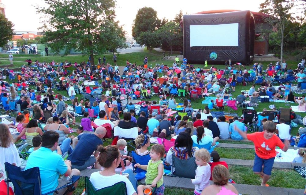 People gather to watch a movie at Dogwood Park.