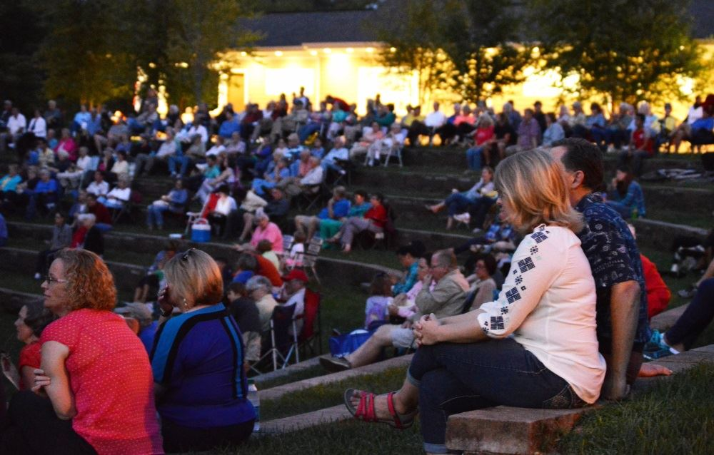A crowd gathers for a concert at Dogwood Park.