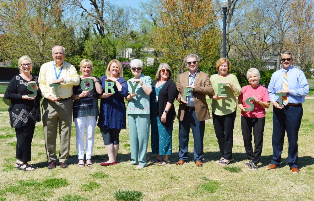 Storyfest organizers and sponsors gather at Dogwood Park.