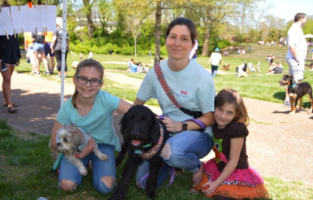 A mother and two daughters bring their dogs to Dogapalooza.