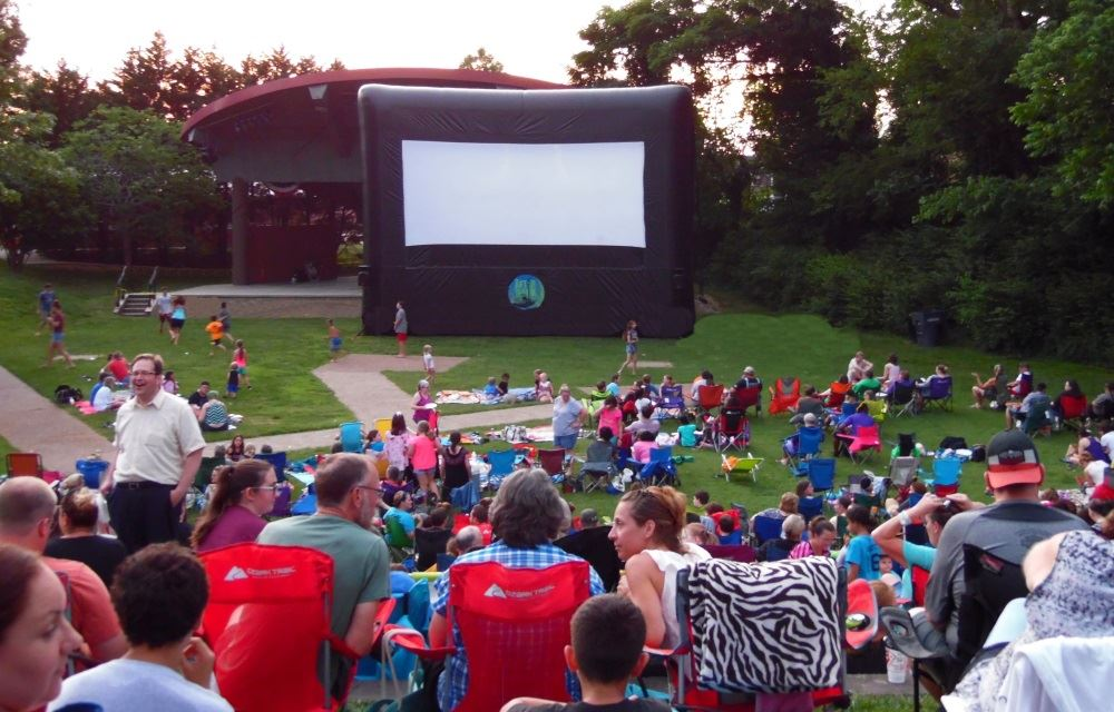 A crowd gathers for an After Dark movie at Dogwood Park.