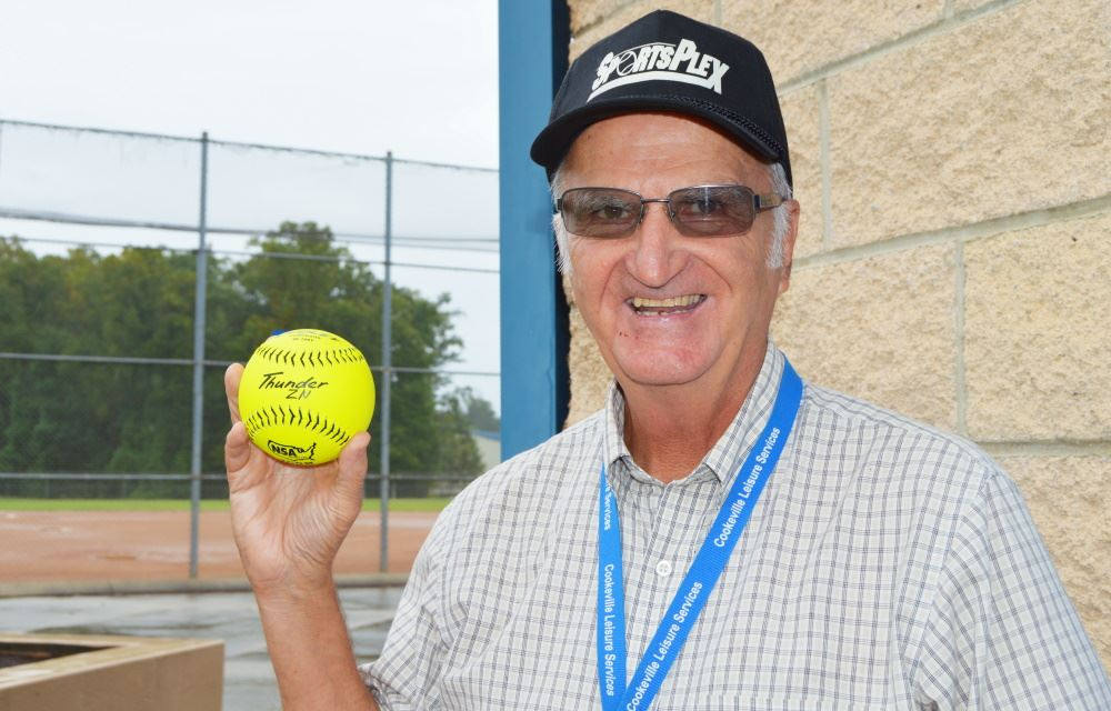 Jim Crea holds a softball at Cane Creek SportsPlex