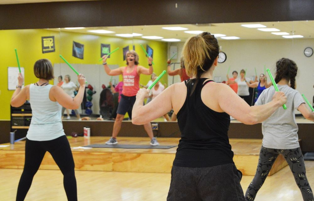 Women participate in a fitness class at Cane Creek Recreation Center.