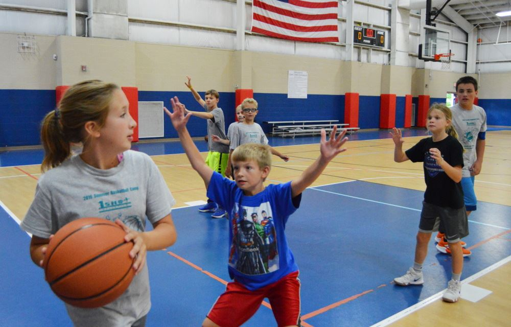 Children play basketball at Cane Creek Gymnasium.