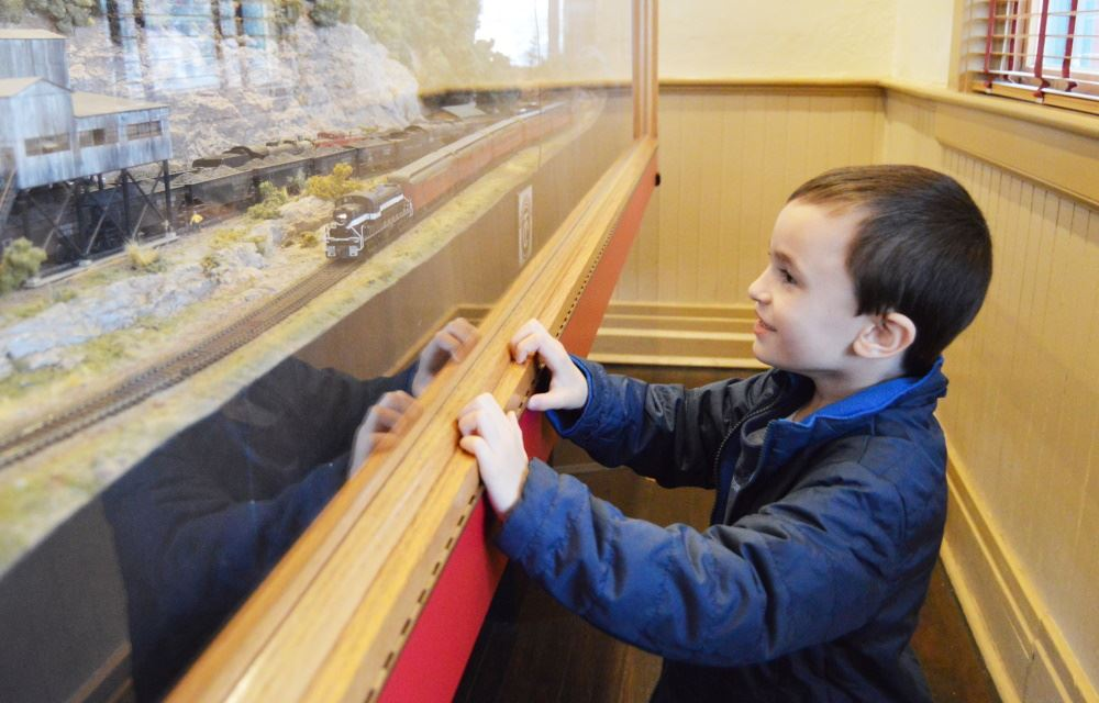 A boy watches a model train at the Cookeville Depot.