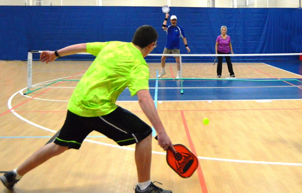 People play pickleball at Cane Creek Gymnasium