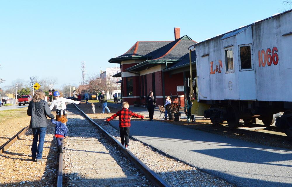People walk outside the Cookeville Depot Museum.