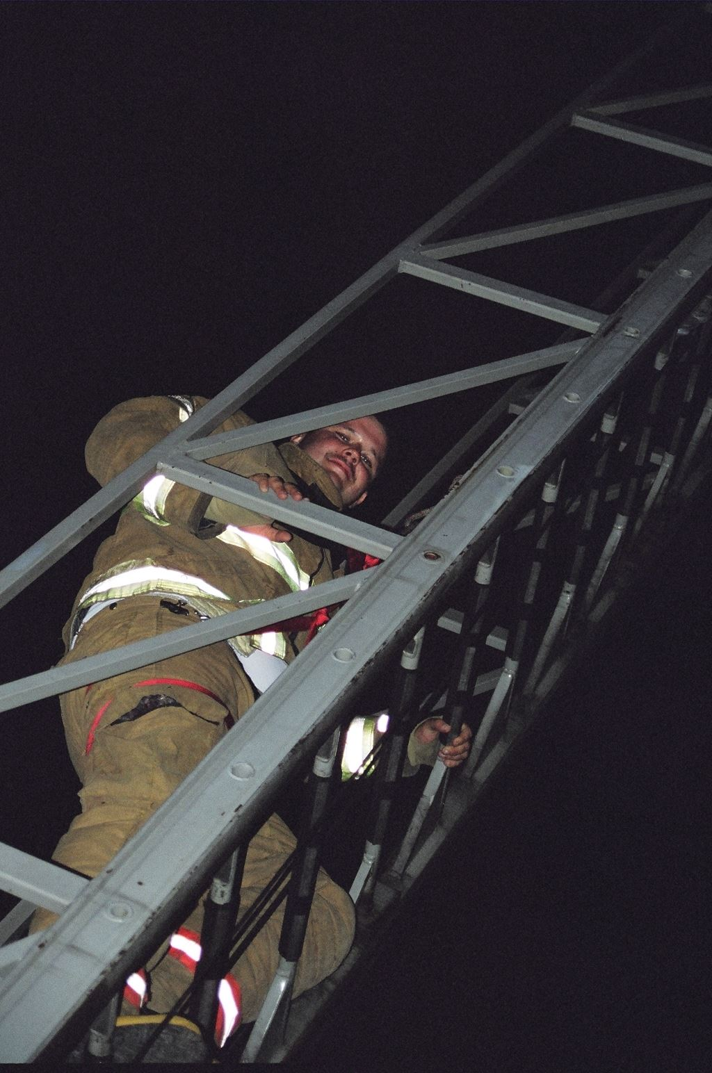 Fire Fighter on a Ladder