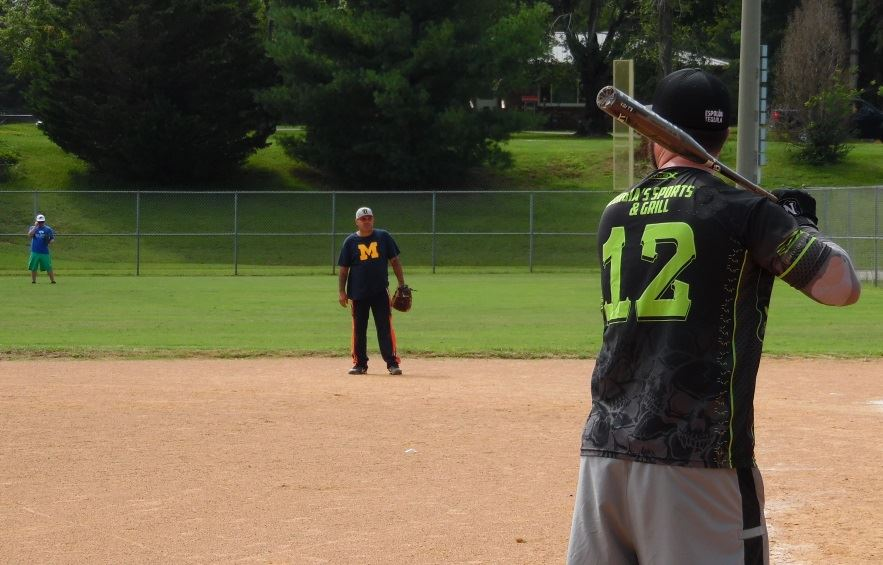 Men play in a softball tournament.
